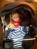 Baby in rain cart