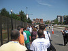 Line of press people waiting in the hot sun to go through security