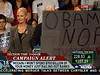 Guy with Obama sign obscures McCain and Little Joe