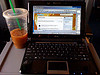 Basic train setup, iced coffee and netbook